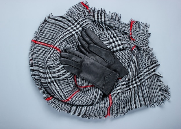Autumn women's accessories. fashionable female scarf, gloves. top view