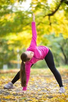 Autumn yoga: trikonasana pose