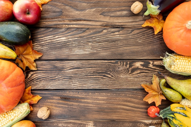 Autumnal frame on wooden table with copy space