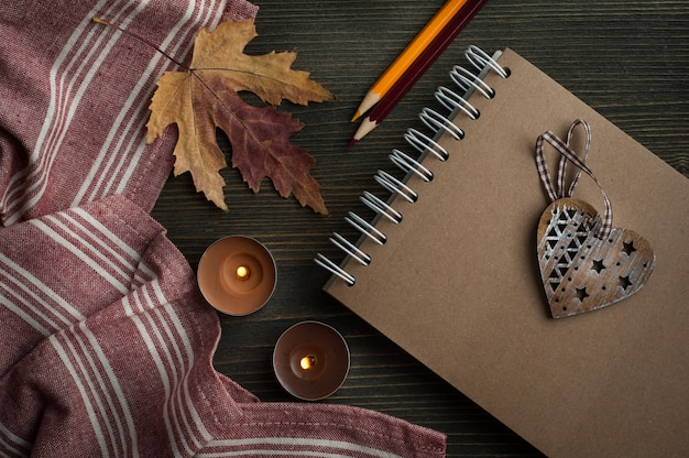 Autumnal leaves and lit candles