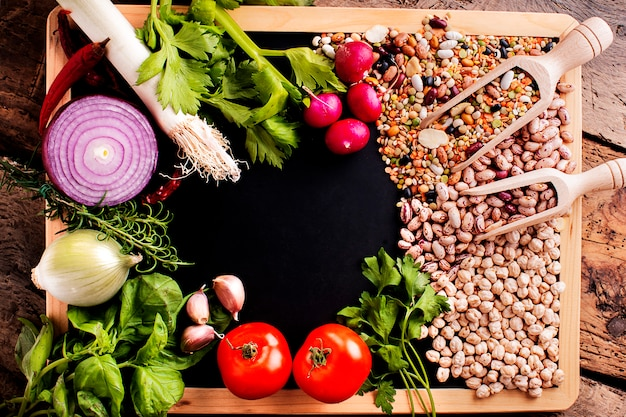 Autumnal raw ingredients for a soup on a blackboard