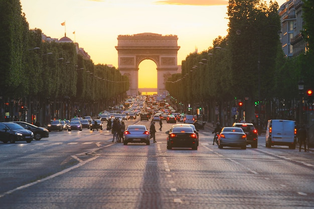 The avenue des champs elysees and arc de triomphe (arch of triumph of the star) in vintage style