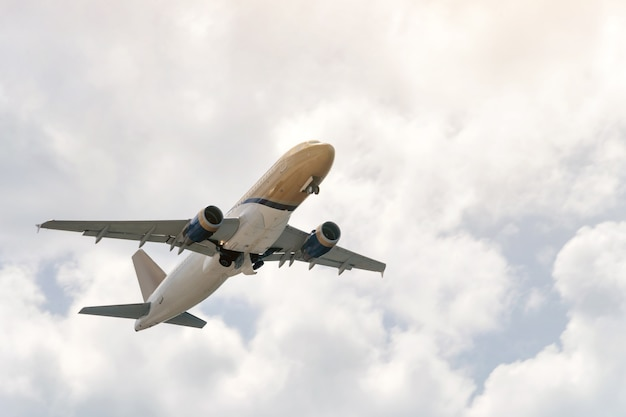 Aviation, travel, air transportation concept. passengers commercial airplane or business jet flying among the clouds.