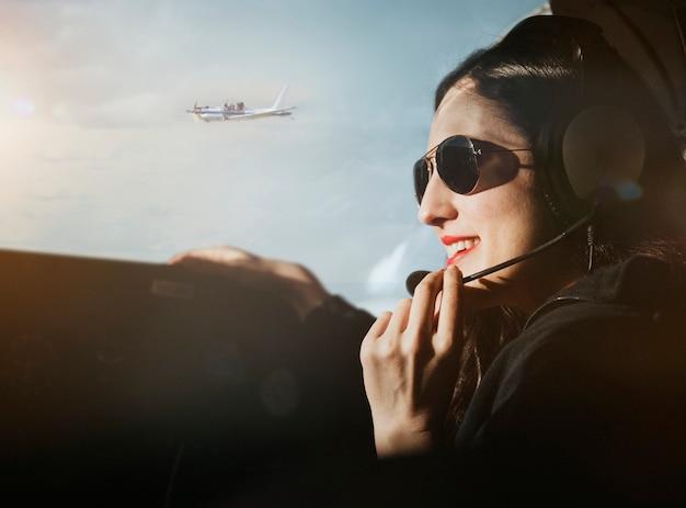 Aviator with headphones listening to the air traffic Premium Photo