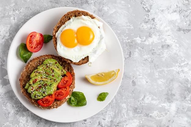 Avicado toast. egg sandwich appetizer. top view