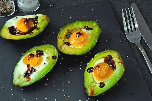 Avocado baked with egg. keto lunch idea.
