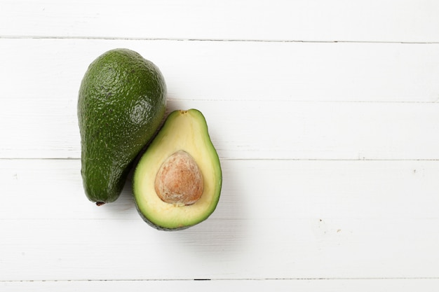 Avocado on a board background