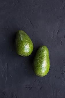 Avocado fruit on a black table