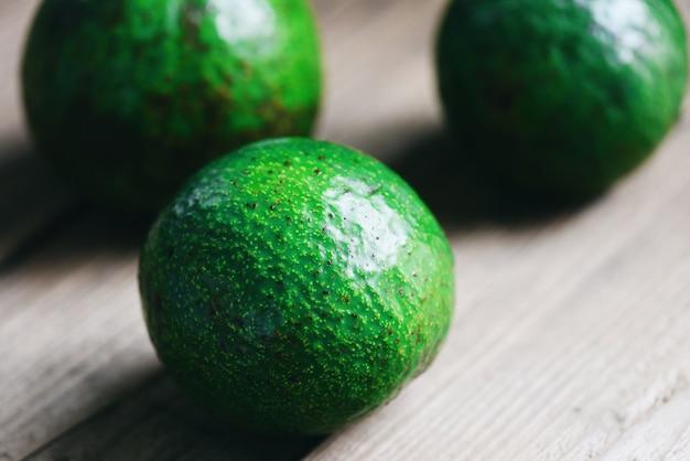 Avocado fruit on wooden