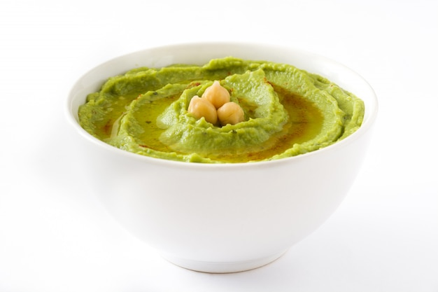 Avocado hummus in bowl isolated on white