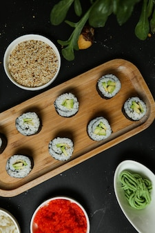 Avocado maki with rice, wasabi, ginger and sesame seeds