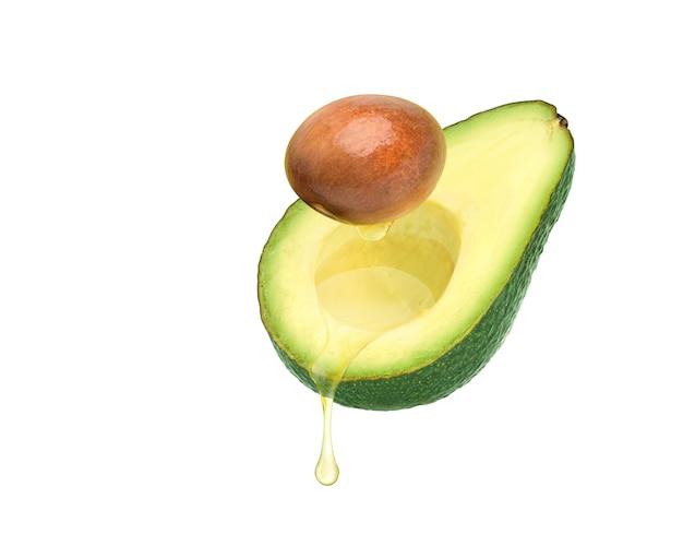 아보카도 과일과 씨앗 흰색 배경에 고립에서 떨어지는 아보카도 오일.