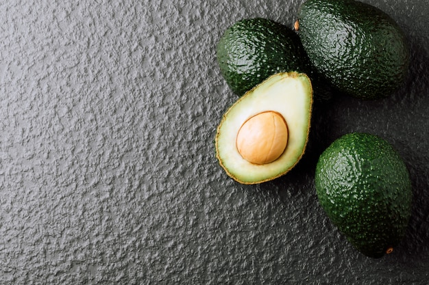 Avocado on old wooden table.