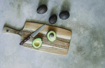 Avocado on a wooden chopping board