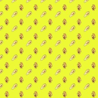 Узор авокадо на желтом фоне. вид сверху зеленых авокадо. баннер.