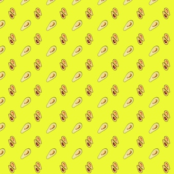 Avocado pattern on a yellow background. top view of green avocados. banner.