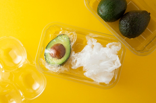 Avocado in plastic bag. effect destroyer of the use of plastic bags. zero waste. avocado.