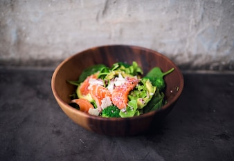 Avocado salmon salad healthy food in rustic style
