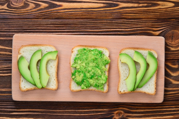 Avocado sandwich on a bread made with fresh sliced avocados from above