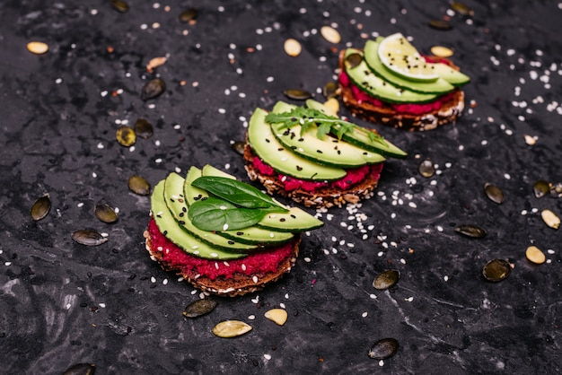 Avocado sandwiches with seeds, sesame and a lime