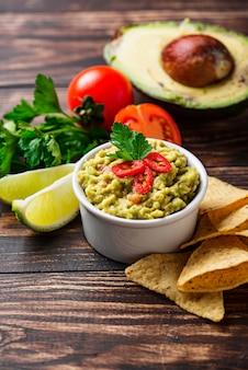 Avocado sauce guacamole with corn chips nachos