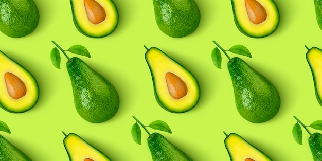Avocado seamless pattern isolated on green background