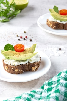 Avocado toast on light base. vertical format.
