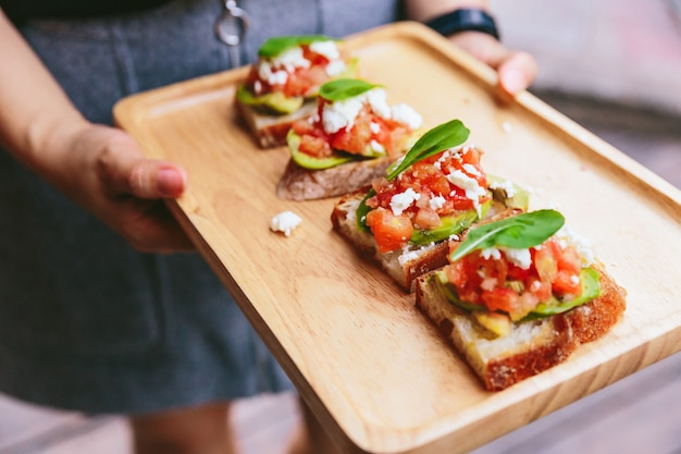 Avocado toast with cherry tomatoes and feta cheese