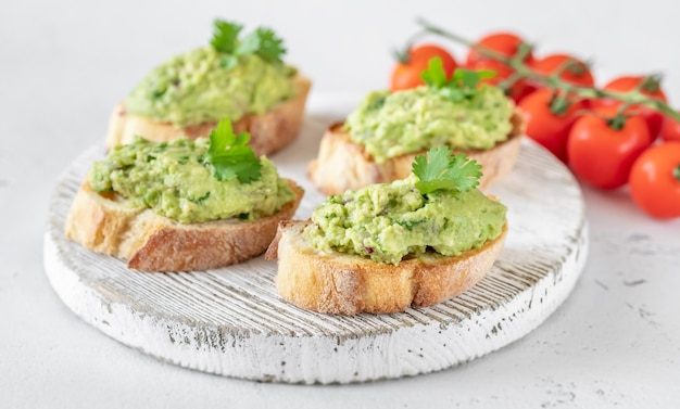 Avocado toasts on the wooden board