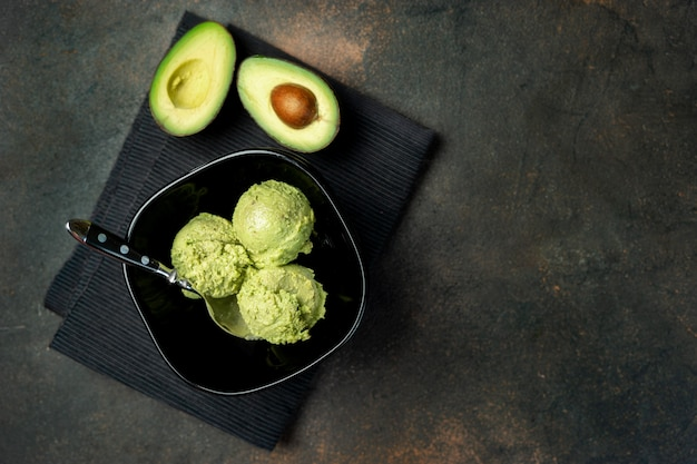 Avocado vegan ice cream on dark background
