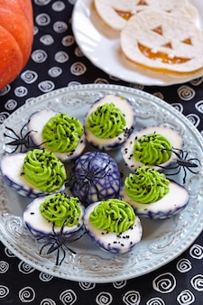 Avocado and wasabi deviled spider web eggs