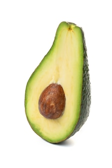 Avocado whole fruit and slices, isolated on a white background