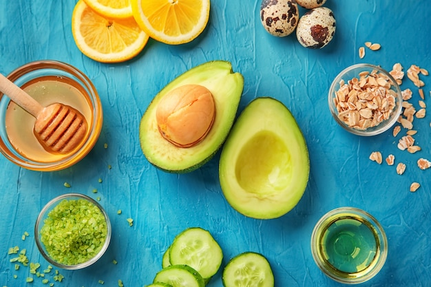 Avocado with ingredients for natural homemade cosmetics