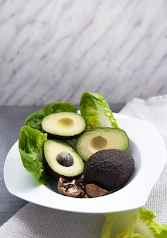 Avocados with lettuce on plate