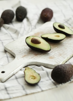 Avocados on wooden cutting board