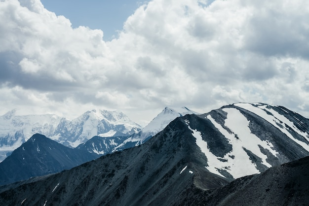Awesome landscape with beautiful huge glacial mountains in overcast weather.