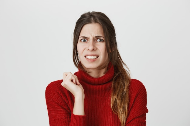 Awkward and disturbed girl cringe from awful scene