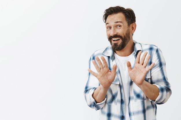 Awkward and worried bearded mature man posing