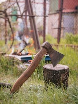 Ax with bonfire