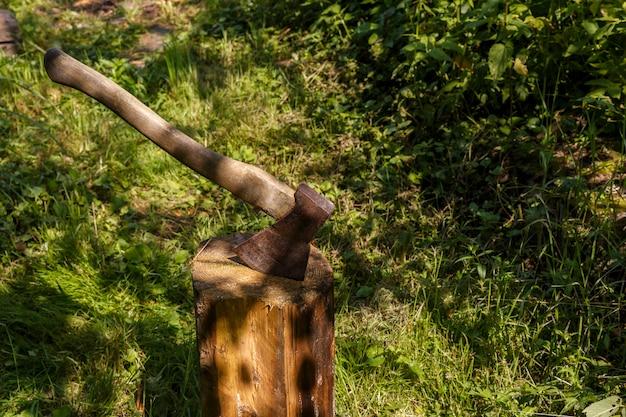 Axe stuck in the stump
