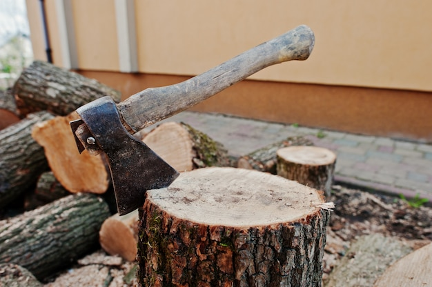 Axe in stump background chopped firewood.