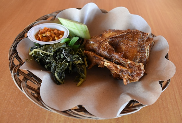 Ayam goreng indonesian fried chicken is traditional indonesian culinary food