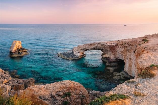 Ayia napa love bridge on mediterranean sea at sunset, cyprus l
