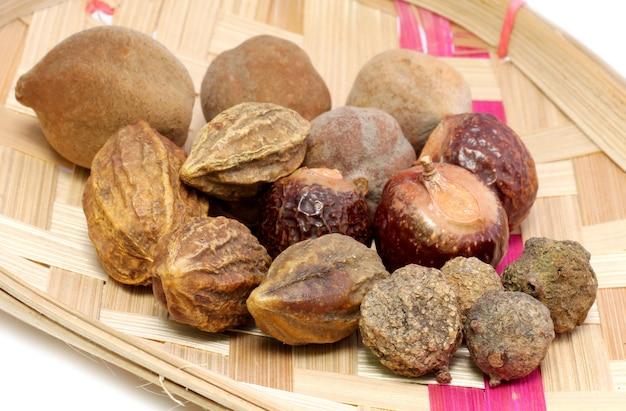 Ayurvedic fruits on bamboo basket have medicinal properties.