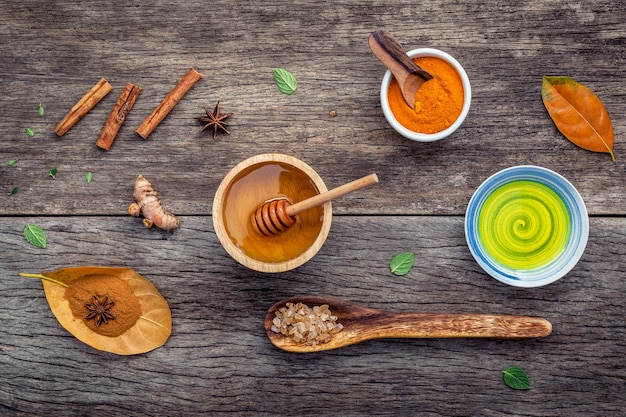 Ayurvedic medicine and nature spa ingredients on shabby wooden table.