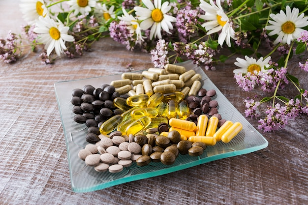 Ayurvedic pills with chamomile and tansy flowers