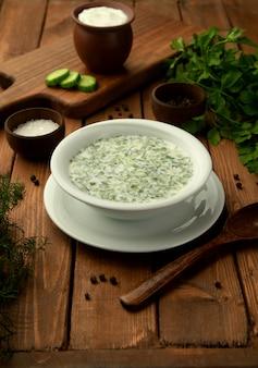 Azerbaijan doghramaj yoghurt soup with fresh herbs