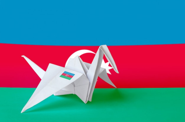 Azerbaijan flag depicted on paper origami crane wing. handmade arts concept