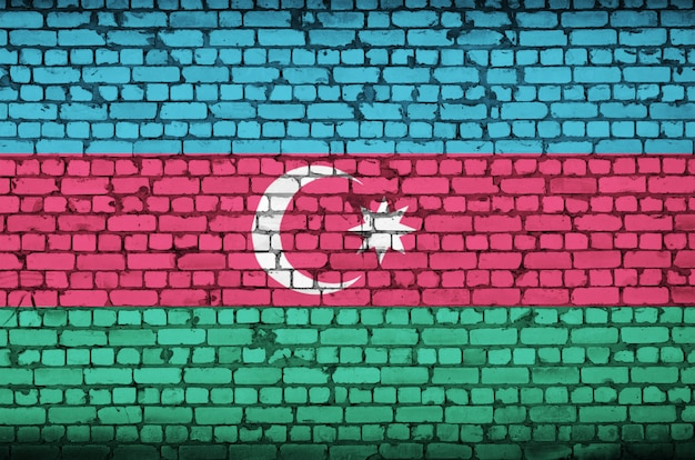 Azerbaijan flag is painted onto an old brick wall