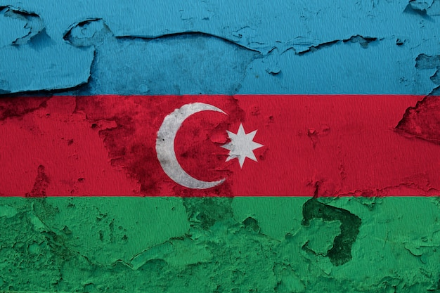 Azerbaijan flag painted on the cracked concrete wall
